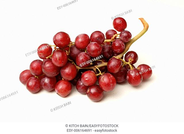 Red grapes isolated on a kitchen bench