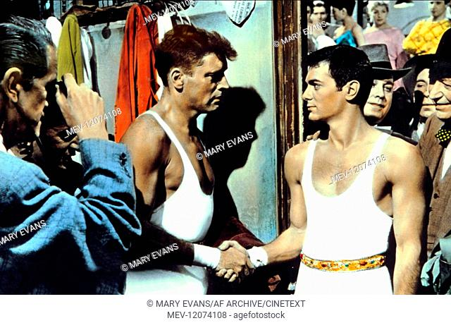 Burt Lancaster & Tony Curtis Characters: Mike Ribble, Tino Orsini Film: Trapeze (USA 1956) Director: Carol Reed 30 May 1956 TRAPEZ (USA) Burt Lancaster