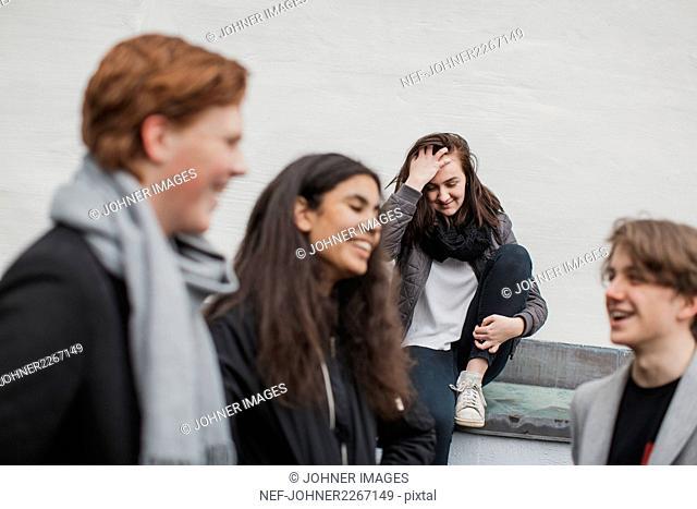 Happy teenagers talking