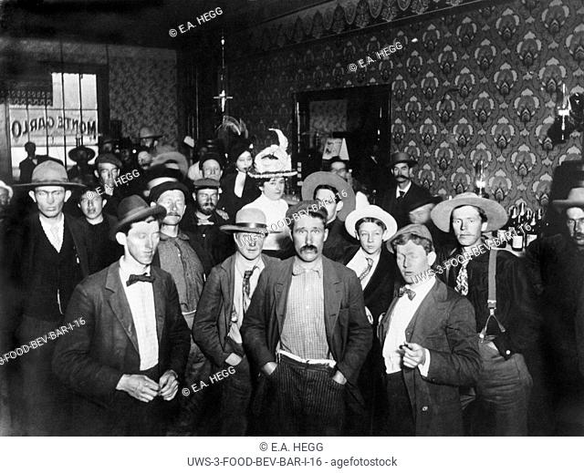 Dawson City, Yukon Territory, Canada: c. 1898 The interior of the Monte Carlo Saloon in Dawson City with its numerous men and two women