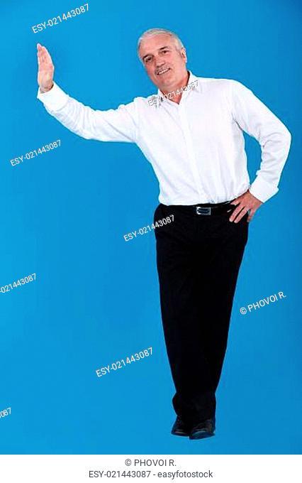 Man pretending to lean against wall