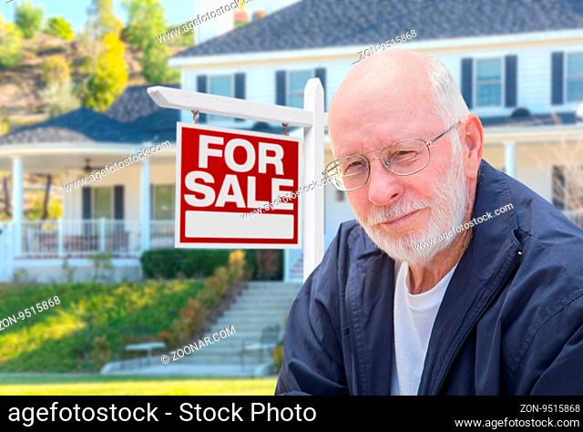 Senior Adult Man in Front of Home For Sale Real Estate Sign and Beautiful House