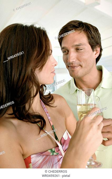 Close-up of a young couple toasting champagne flutes