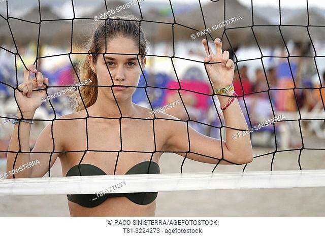 Girl playing beach volleyball. Peñíscola, Castellon Province, Spain