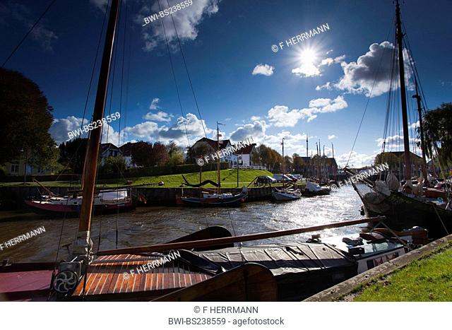 ships anchoring in a canal, Germany, Lower Saxony, East Frisia, Wittmund