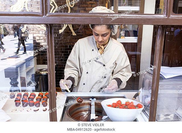 England, London, Covent Garden, Godiva Store, Woman Making Chocolate Dipped Strawberries