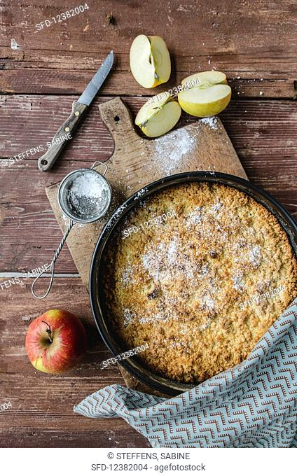 Apple cake, fresh apples and icing sugar