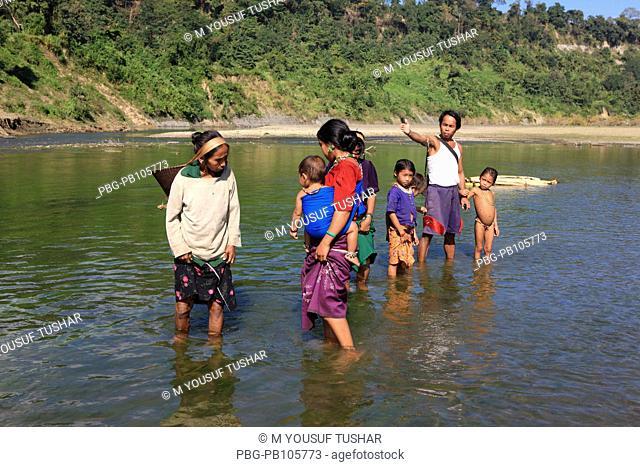 Tribal people wade at the Sangu River at Thanchi Bandarban, Bangladesh December 2009