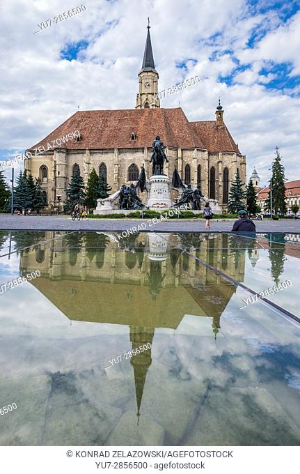Gothic style Roman Catholic Church of Saint Michale and monument of Matthias Corvinus on Union Square in Cluj Napoca city in Romania