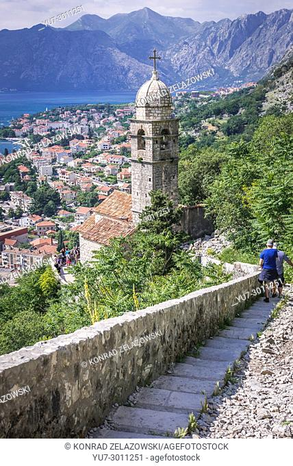 Bell tower of Church of Our Lady of Remedy on the slope of Saint John mountain above Old Town of Kotor town in Bay of Kotor, Montenegro