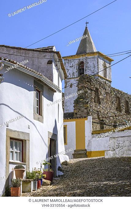 Narrow street and Bell tower of Santa Catarina Convent in the Medieval quarter of Castle, Castelo de Vide village, Portalegre District, Alentejo Region
