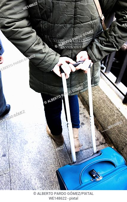 Person walking with trolley in madrid, Spain