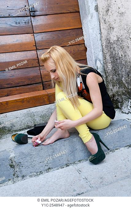 Young woman ad-hoc pedicure outdoors