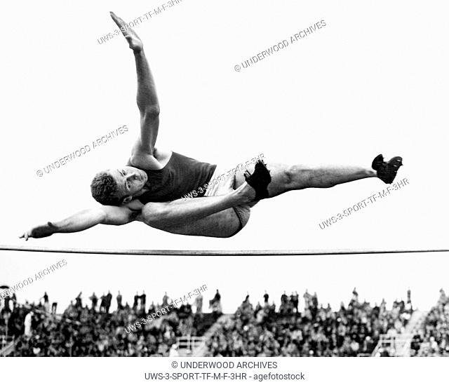 New York, New York: June 4, 1938 1936 Olympic bronze medal winner Delos Thurber of the University of Southern California makes his wining leap in the high jump...