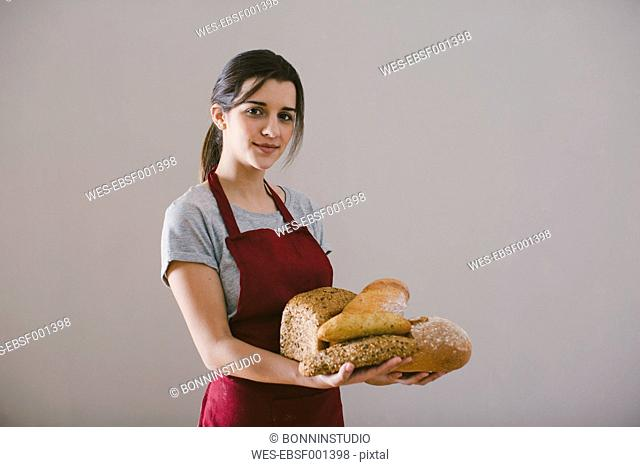 Woman holding different home made breads