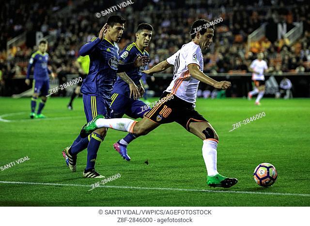 Valencia CF vs Real Celta de Vigo - La Liga Matchday 30 - Estadio Mestalla, in action during the game -- Dani Parejo (C) midfielder for Valencia CF kicks the...