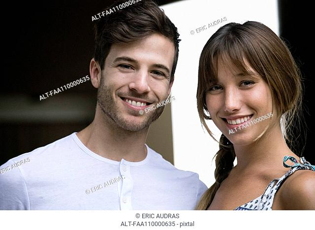 Smiling young couple, portrait