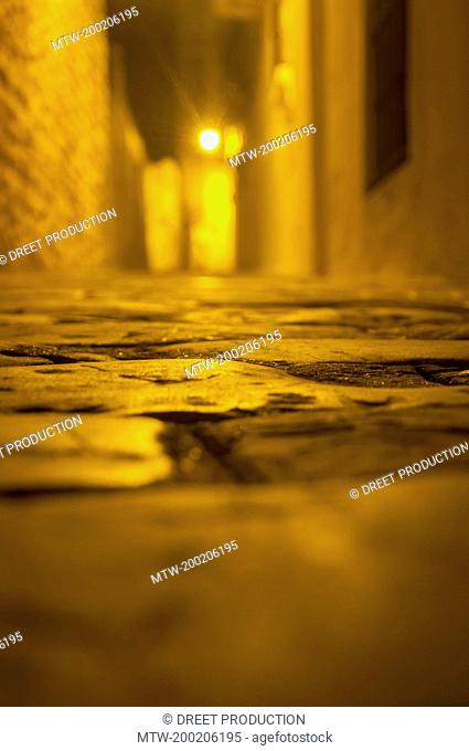 Empty cobblestone pavement at night, Vejer de la Frontera, Andalusia, Spain