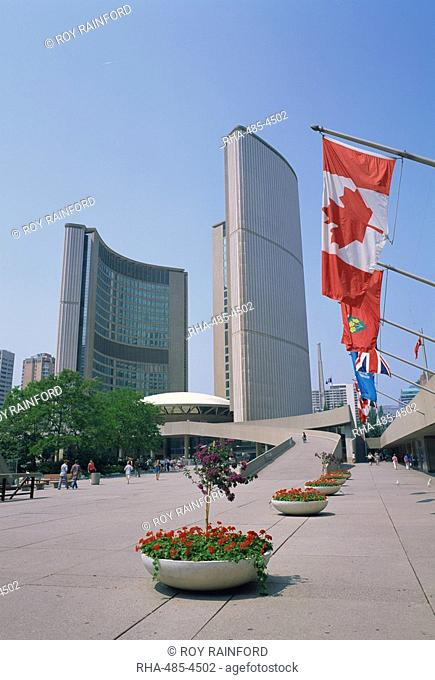 Flags outside the modern buildings of City Hall in Toronto, Ontario, Canada, North America