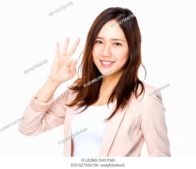Asian Buisnesswoman showing ok sign gesture