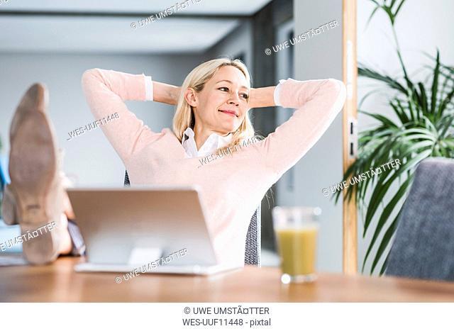 Businesswoman having a break in office