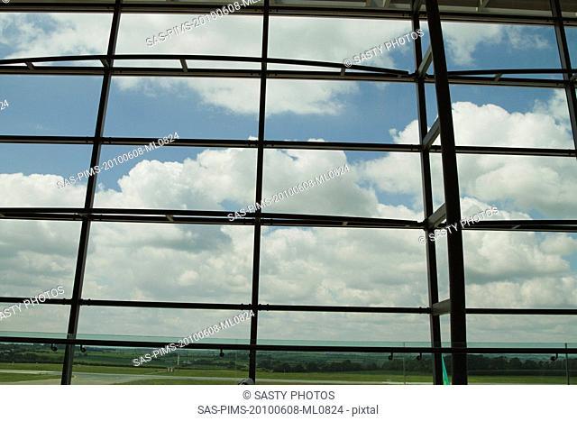 Clouds viewed through an airport lounge window, Cork Airport, Cork, County Cork, Republic of Ireland