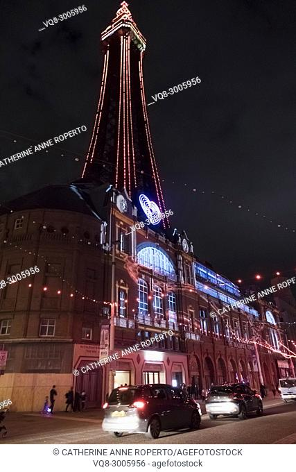 'Love Blackpool' Tower, pink and purple heart illuminations punctuated by swathes of pink bulbs and car tail lights, Blackpool, England