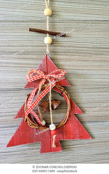 close up of Christmas tree shaped decoration on wooden background