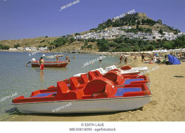 Greece, island Rhodes, Lindos,  view at the city, acropolis, Pallas bay,  Beach, tourists,  Dodekanes, Mediterranean island, coast, cityscape, houses