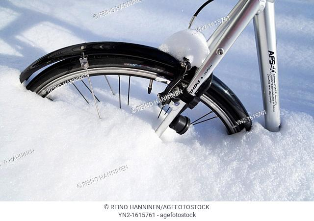 Bicycle wheel stuck in snowbank. Location Oulu Finland Scandinavia Europe