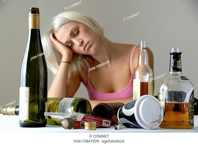 Woman, young, sitting, overdose, ill, sick, drugs, alcohol, bottles, beverages, wine, drunk, party, bingedrinking, dri