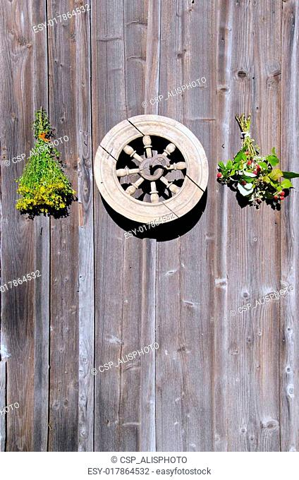 tutsan and raspberry bunches and wheel on wall