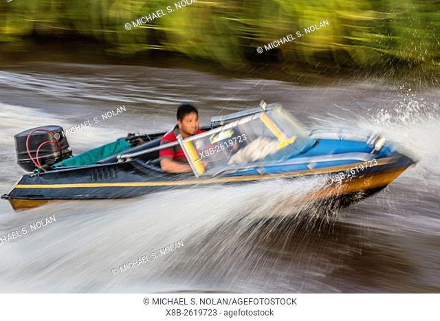 Local small speed boat on the Sekonyer River, Tanjung Puting National Park, Borneo, Indonesia