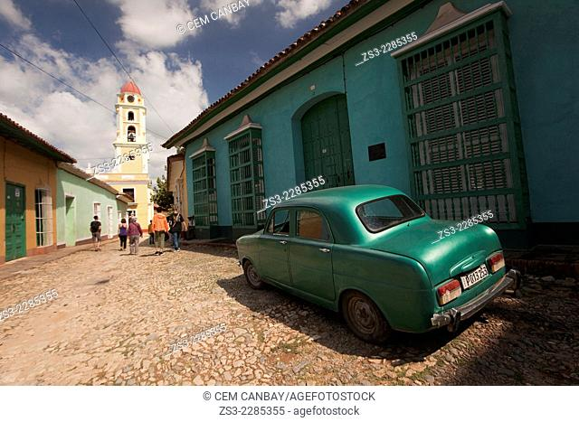 Old american car parked at the street side near Museo Nacional de la Lucha Contra Bandidos, National Museum of the Fight Against Bandits, Trinidad