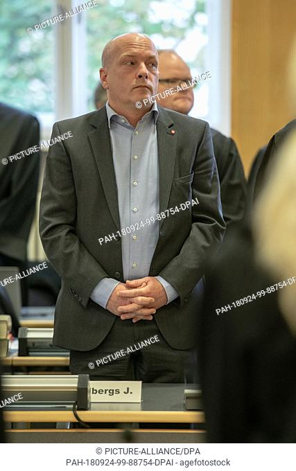 24 September 2018, Bavaria, Regensburg: Joachim Wolbergs (SPD), the suspended Lord Mayor of Regensburg, stands in the courtroom of the Regional Court