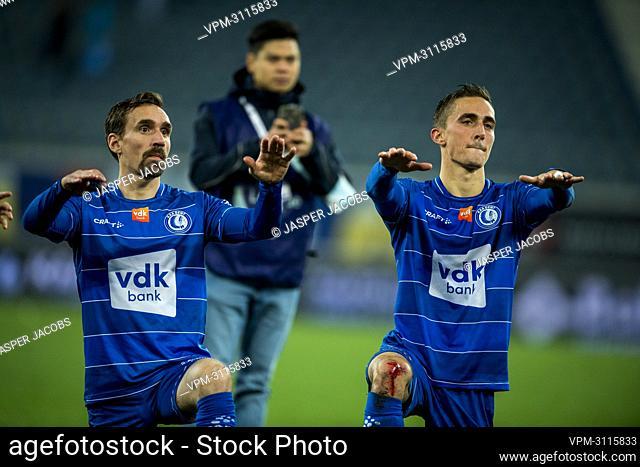 Gent's Sven Kums and Gent's Julien De Sart celebrate after winning a soccer match between KAA Gent and KAS Eupen, Sunday 17 October 2021 in Gent
