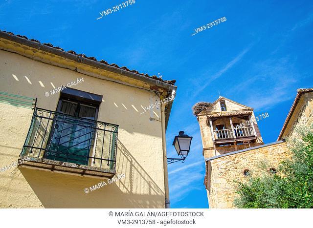 Facade of house and San Pedro Excatedra church. Montejo de la Sierra, Madrid province, Spain