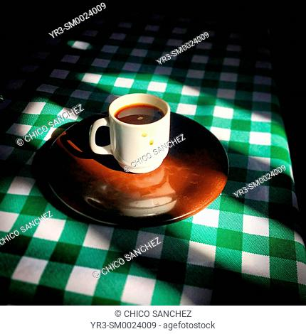 A coffee in a squared table in a restaurant in Dolores Hidalgo, Guanajuato, Mexico