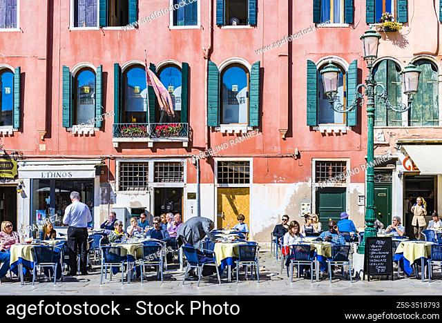 Lively terraces in the Campo Santo Stefano is a city square near the Ponte dell'Accademia, in the sestiere of San Marco. Venice, Veneto, Italy, Europe