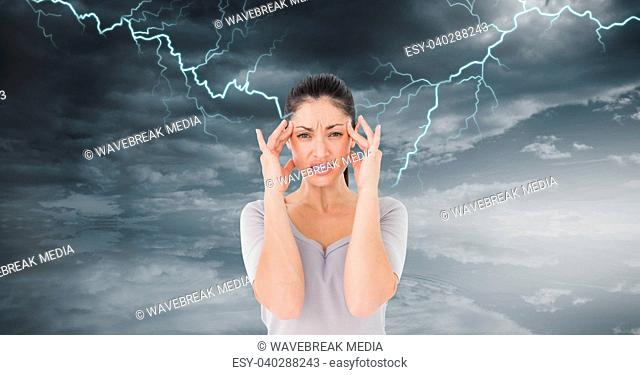 Lightning strikes and stressed woman with headache holding head
