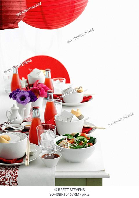 Table set with Chinese food and soda