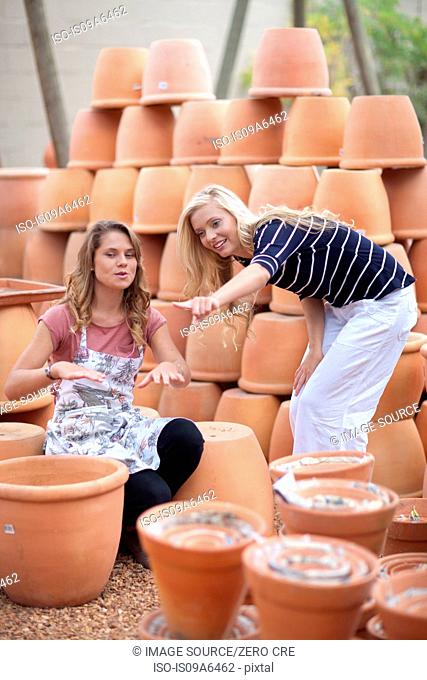 Woman shopping for planters in nursery