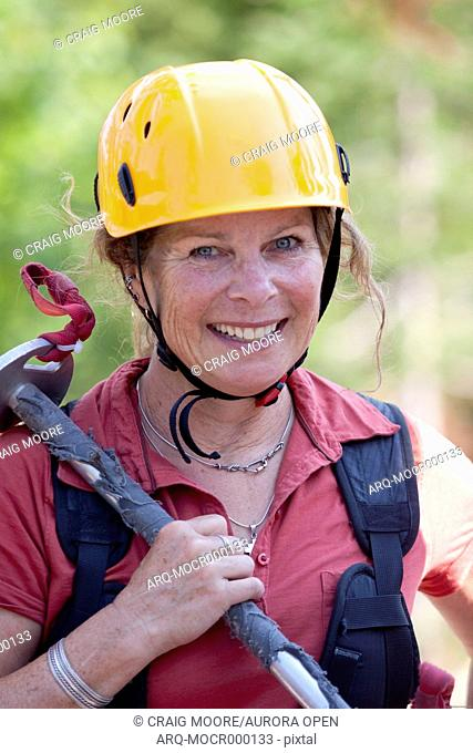 A woman on a zip line tour in Whitefish, Montana