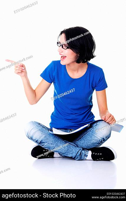 Student woman pointing on copy space