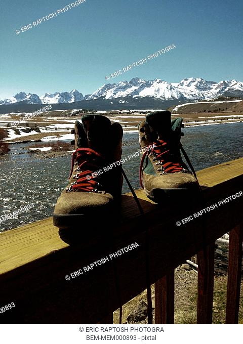 Hiking boots on snowy balcony