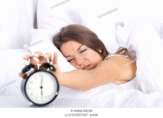 Woman in bed waking up, Debica, Poland