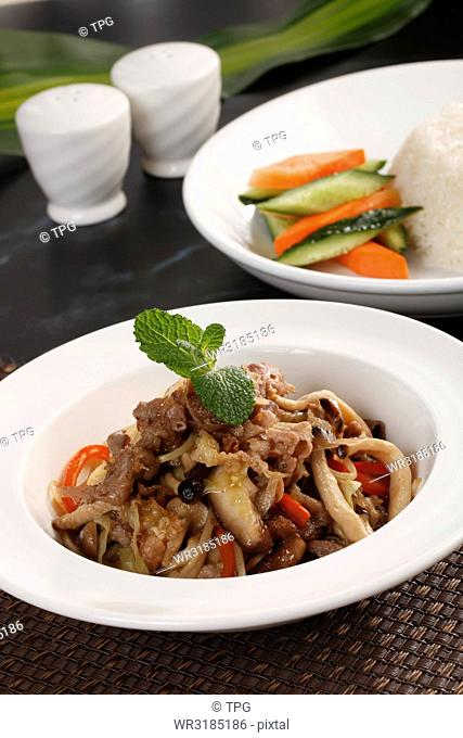 vegetable with pork over rice