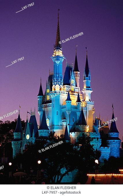 Illuminated fairy-tale castle at night, Magic Kingdom, Disneyworld, Orlando, Florida, USA, America