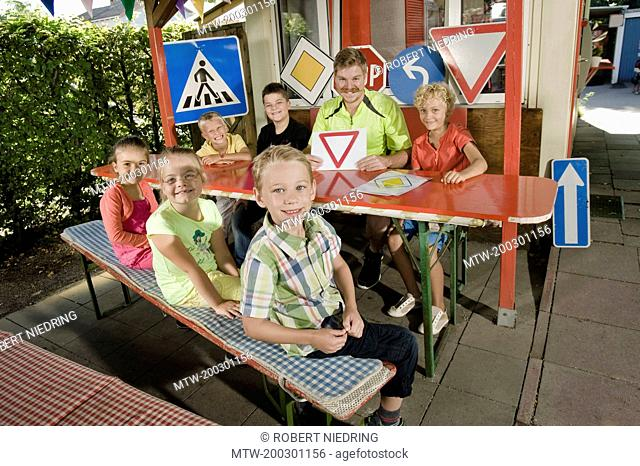 Children and young man at driver training area