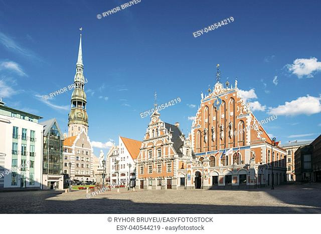 St. Peter's Church And House Of The Blackheads In Riga, Latvia. Sunny Summer Day With Blue Sky. Famous Landmark. Old Architecture. Travel Destination